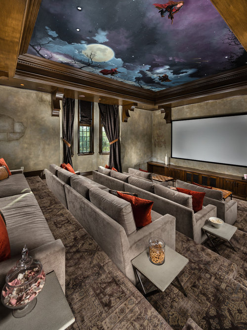 Huge Tuscan Enclosed Carpeted And Gray Floor Home Theater Photo In Los  Angeles With A Projector