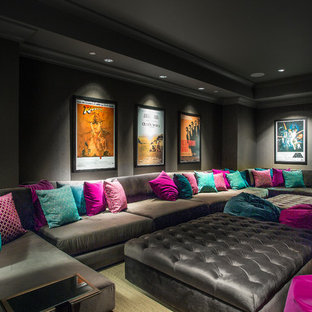 Inspiration for a transitional home theater remodel in Other with black walls