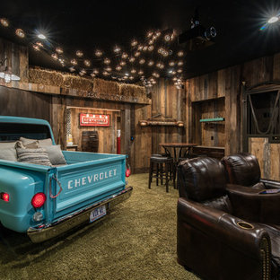 Example of a mountain style enclosed carpeted and green floor home theater design in Charlotte with brown walls