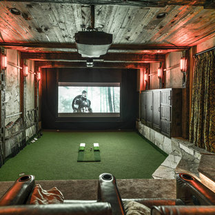 Home theater - large rustic enclosed home theater idea in Minneapolis with brown walls and a projector screen