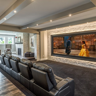 Home theater - traditional open concept carpeted and multicolored floor home theater idea in Other with a projector screen