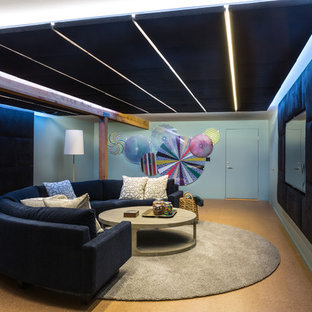 Example of a mid-sized danish enclosed cork floor and brown floor home theater design in DC Metro with blue walls and a wall-mounted tv