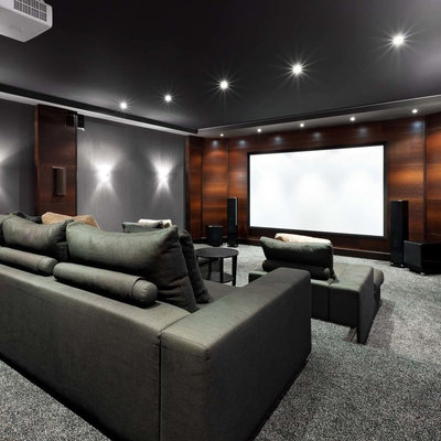 Mid-sized trendy enclosed carpeted home theater photo in Jacksonville with gray walls and a projector screen