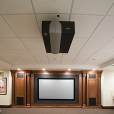 Traditional Home Theater by Marius Daugvila