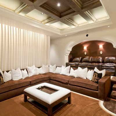 Large tuscan enclosed carpeted and brown floor home theater photo in Phoenix with brown walls
