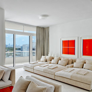 Inspiration for a contemporary white floor home theater remodel in Miami with white walls
