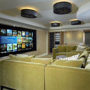 Design ideas for a bohemian home cinema in New York with a projector screen.
