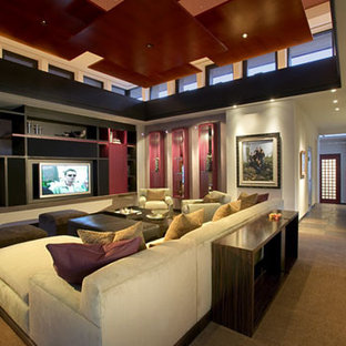 Inspiration for a large modern open concept home theatre in Phoenix with grey walls, slate floors, a wall-mounted tv and brown floor.