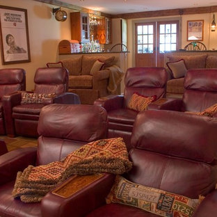 Inspiration for a mid-sized rustic enclosed carpeted and brown floor home theater remodel in Boston with yellow walls and a projector screen
