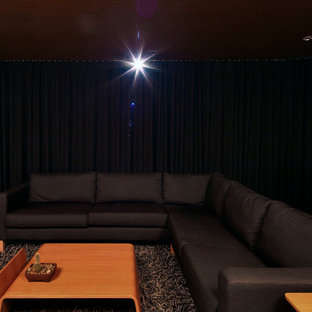 Home theater - mid-sized contemporary enclosed concrete floor and brown floor home theater idea in Seattle with brown walls and a projector screen