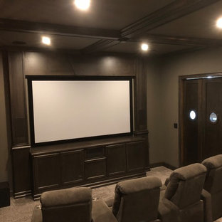 Example of a mid-sized urban enclosed carpeted and gray floor home theater design in Other with gray walls and a projector screen