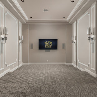 Design ideas for an expansive mediterranean enclosed home theatre in Phoenix with beige walls, carpet, a wall-mounted tv and grey floor.