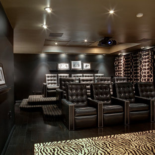 Example Of A Trendy Enclosed Black Floor Home Theater Design In New York With Walls