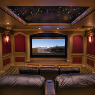 Large Elegant Enclosed Carpeted And Multicolored Floor Home Theater Photo  In Other With Red Walls And