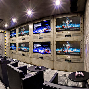 Mid-sized trendy enclosed carpeted home theater photo in Calgary with multicolored walls and a media wall