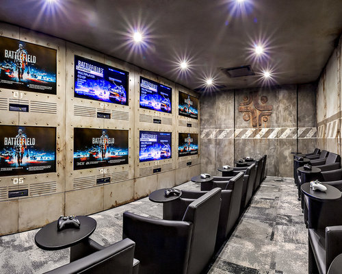 Mid sized industrial enclosed carpeted home theater idea in Calgary with  multicolored walls and a. Video Game Room   Houzz