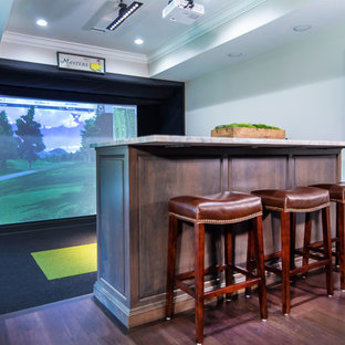 Golf simulator and bar area in basement of mountain home.