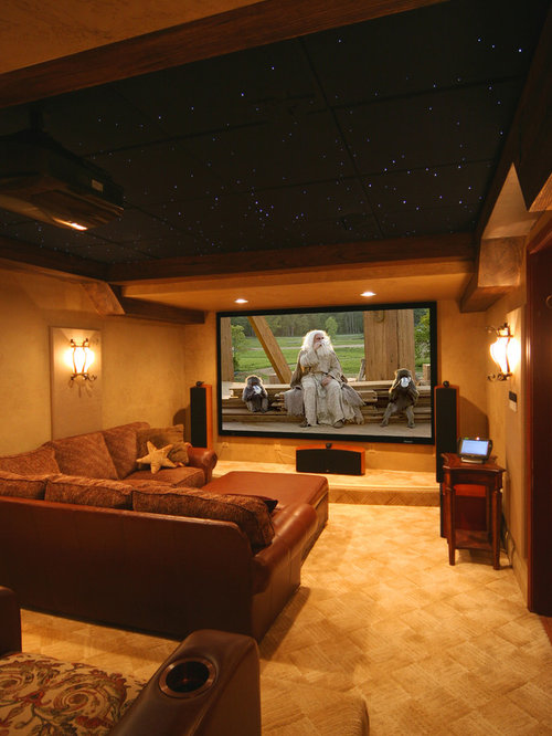 Inspiration for a timeless enclosed carpeted home theater remodel in dc metro with a projector screen