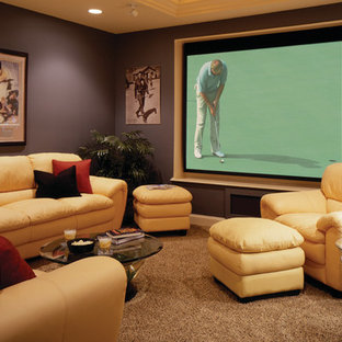 Mid-sized transitional enclosed home theatre in New York with purple walls, carpet, a projector screen and brown floor.