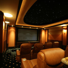 Traditional Home Theater by SKD Architects