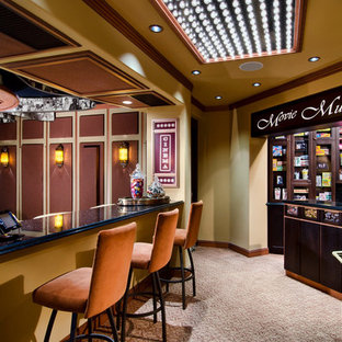 Home theater - huge mediterranean enclosed carpeted home theater idea in Miami with brown walls and a projector screen