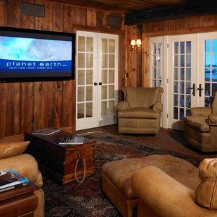 Mittelgroßes, Abgetrenntes Maritimes Heimkino mit brauner Wandfarbe, Backsteinboden und Wand-TV in Boston