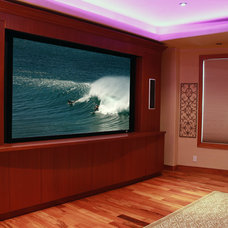 Tropical Home Theater by Tervola Designs
