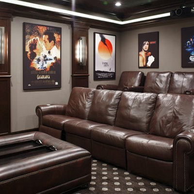 Inspiration for a mid-sized timeless enclosed carpeted and multicolored floor home theater remodel in Tampa with a projector screen and gray walls