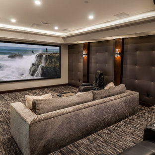 Huge transitional enclosed carpeted home theater photo in Los Angeles with a projector screen