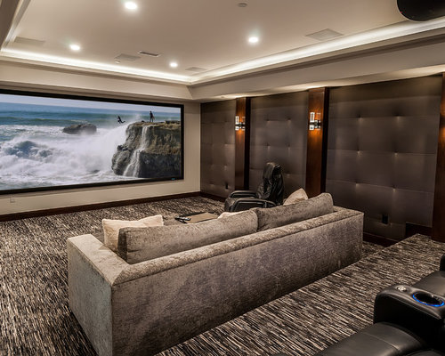 Huge Trendy Enclosed Carpeted Home Theater Photo In Los Angeles With A  Projector Screen
