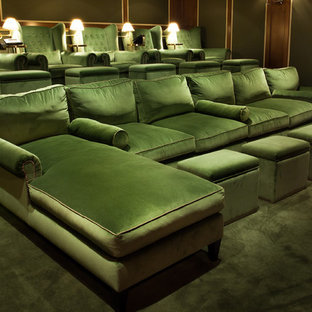 Design ideas for a large traditional enclosed home cinema in Los Angeles with beige walls, carpet, a projector screen and green floors.