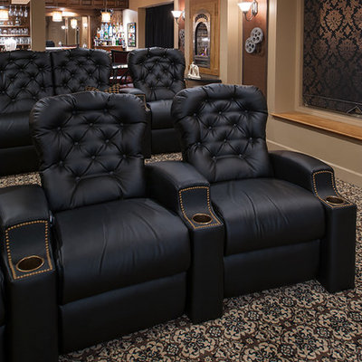Example of a mid-sized classic enclosed carpeted and multicolored floor home theater design in New York with beige walls and a projector screen