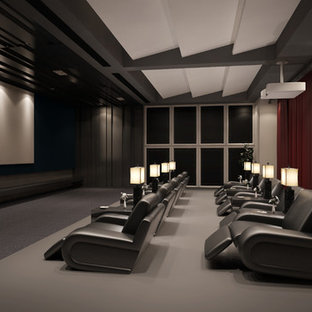 Design ideas for a large modern enclosed home cinema in Atlanta with carpet, a projector screen, white walls and grey floors.