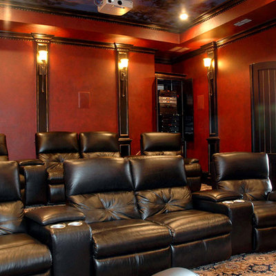 Example of a large classic enclosed carpeted and multicolored floor home theater design in Austin with red walls and a projector screen