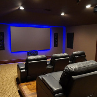 Elegant home theater photo in Austin with a projector screen