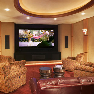 Trendy enclosed home theater photo in Minneapolis with a media wall