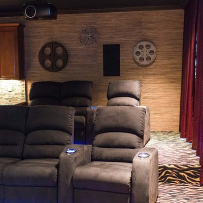 Large elegant enclosed carpeted and multicolored floor home theater photo in Charlotte with a projector screen and beige walls
