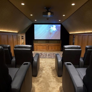 Mid-sized elegant enclosed carpeted home theater photo in Chicago with beige walls and a projector screen