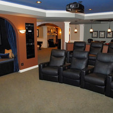 Traditional Home Theater by Phantom Theater and Sound