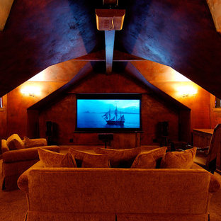 Inspiration for a rustic enclosed home theater remodel in Other