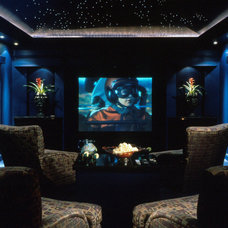 Modern Home Theater by The Evans Group