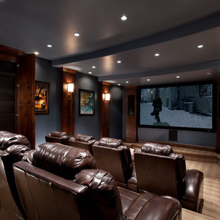 Home theater - traditional brown floor home theater idea in Salt Lake City with blue walls