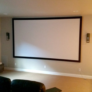 Mid-sized contemporary enclosed home theatre in Other with white walls, carpet, a projector screen and beige floor.