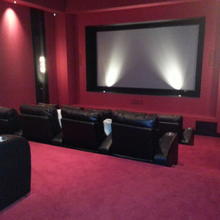 Inspiration for a traditional open concept home theatre in Other with carpet, a projector screen, pink walls and pink floor.