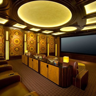 Design ideas for an eclectic home theatre in Los Angeles with a projector screen.