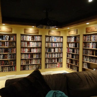 Example of a mountain style enclosed carpeted home theater design in Ottawa with yellow walls