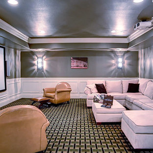 Home theater - mid-sized rustic enclosed carpeted and green floor home theater idea in Other with green walls and a projector screen