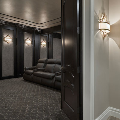 Huge transitional enclosed carpeted home theater photo in Detroit with brown walls and a projector screen