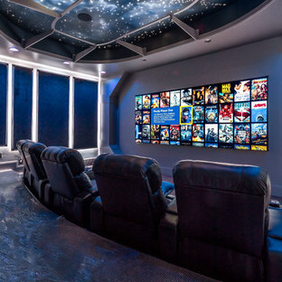Home theater - large transitional open concept carpeted and gray floor home theater idea in Salt Lake City with gray walls and a media wall