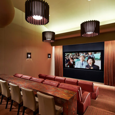 Example of a huge southwest enclosed carpeted and multicolored floor home theater design in Orange County with a projector screen and white walls